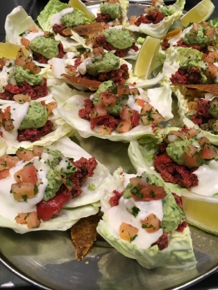 white cabbage shells loaded with smoked aubergine meat, guacamole and raw cream cheese topped with tomato salsa