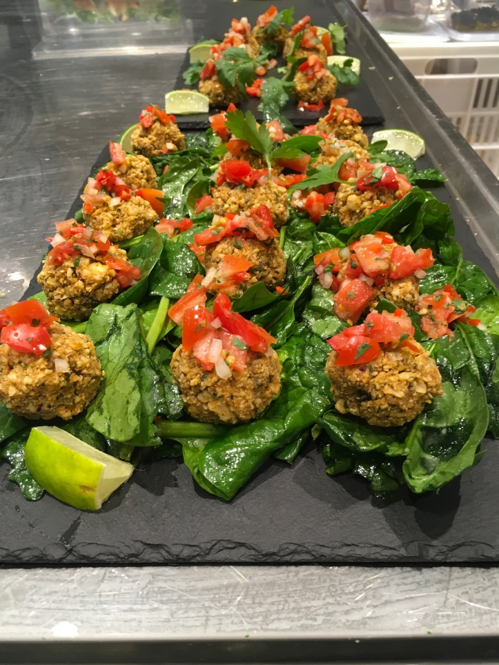 Thai chilli cakes with a spiced tomato relish and massaged lime spinach